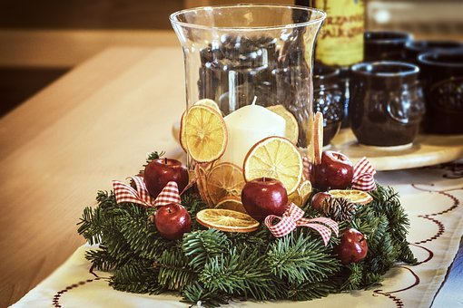 holidays, candle in glass votive with fruit, ribbons and wreath