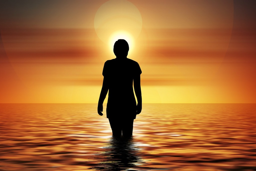 inner peace, silhouette of person standing in water at sunset