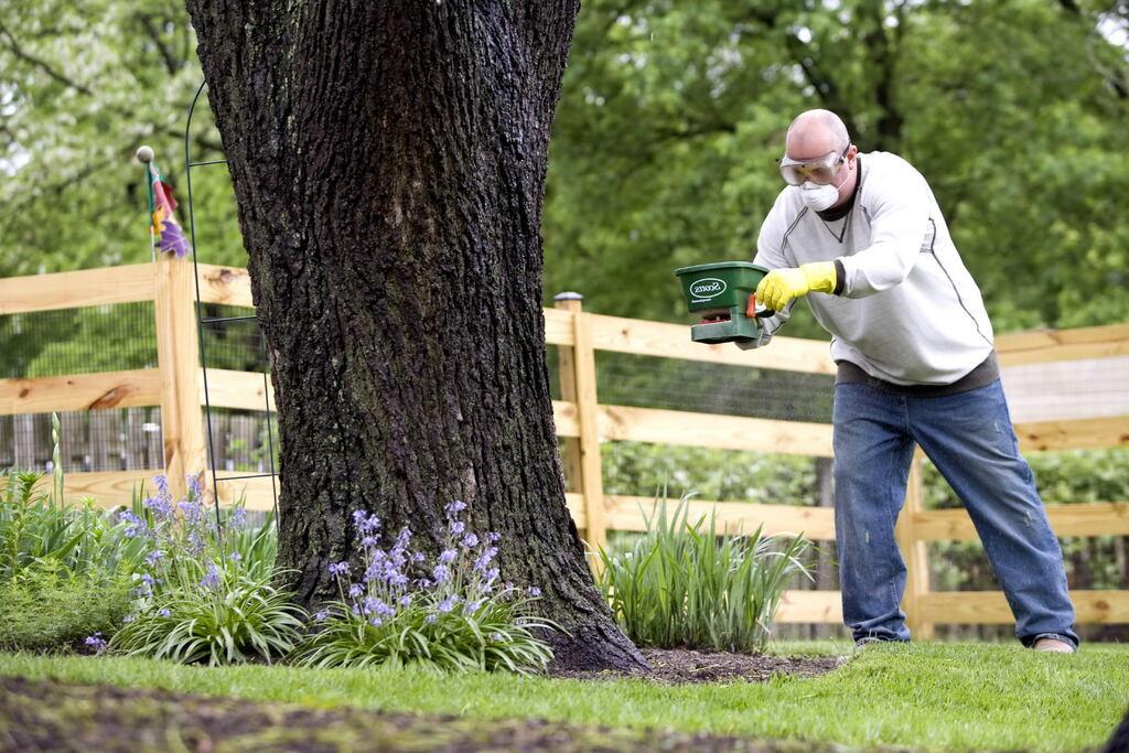 man spraying Fertilizer