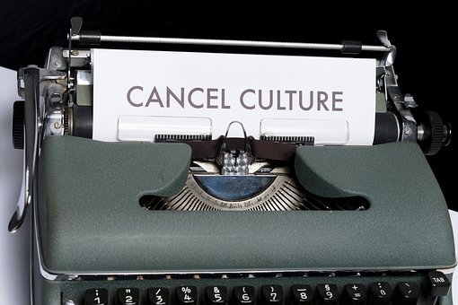 "Mike Lindell, typewriter with words ""cancel culture"" on paper"