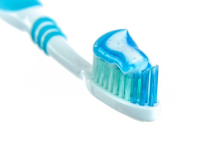obscure facts, bright blue toothpaste on blue and white toothbrush