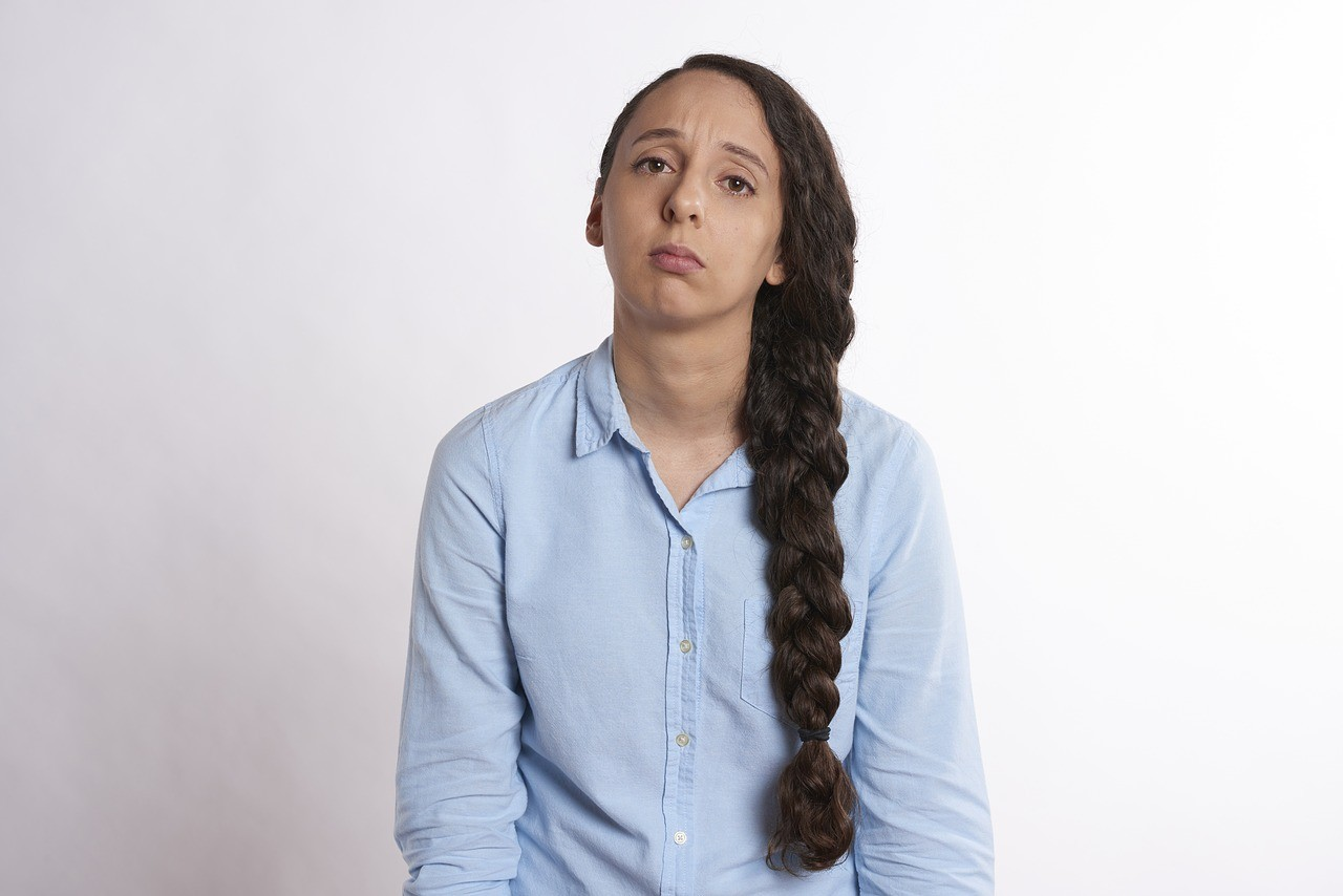 cognitive function, girl with long braid, blue shirt, looking fatigued