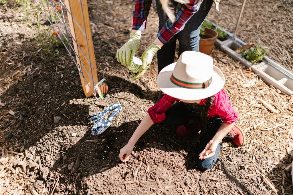 Child making compost