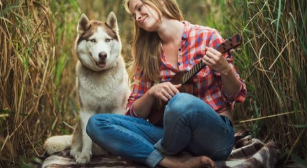Woman singing to dog