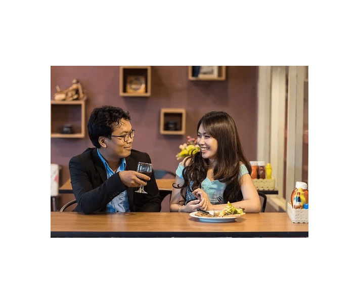 conversation, Asian man and woman sharing meal and talking
