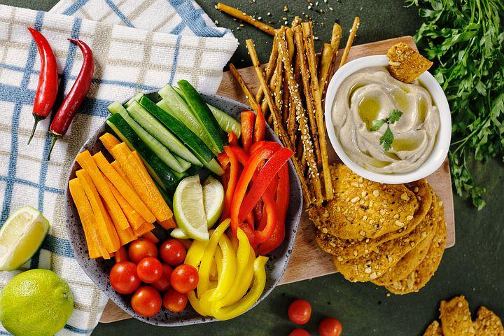 platter of fresh fruits and vegetables, dip, grain crackers