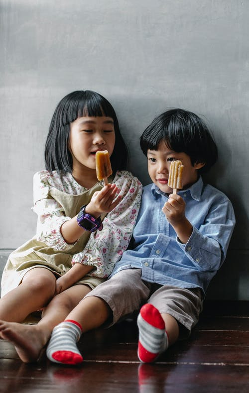homemade popsicle recipes, Asian girl and boy holding popsicles