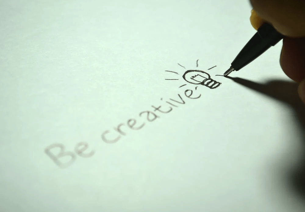 """writing skills, tip of pen writing words """"be creative"""""""