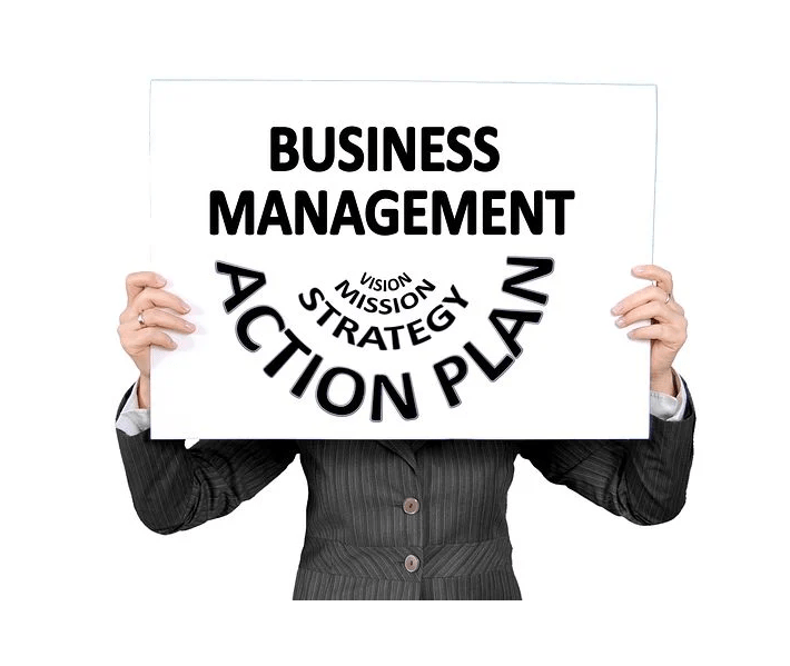 leadership qualities, hands holding up sign that says business management, vision, mission, strategy, action, plan