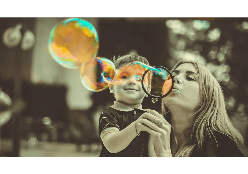 help kids, woman and girl blowing bubbles
