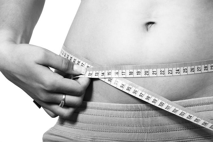 get healthy, hand holding measuring tape around a waist