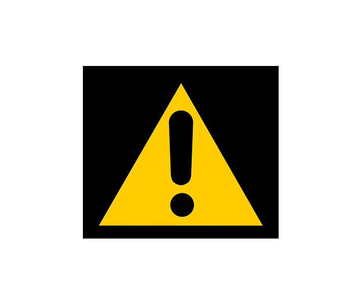 tea tree, yellow caution sing with black exclamation point inside triangle, black background