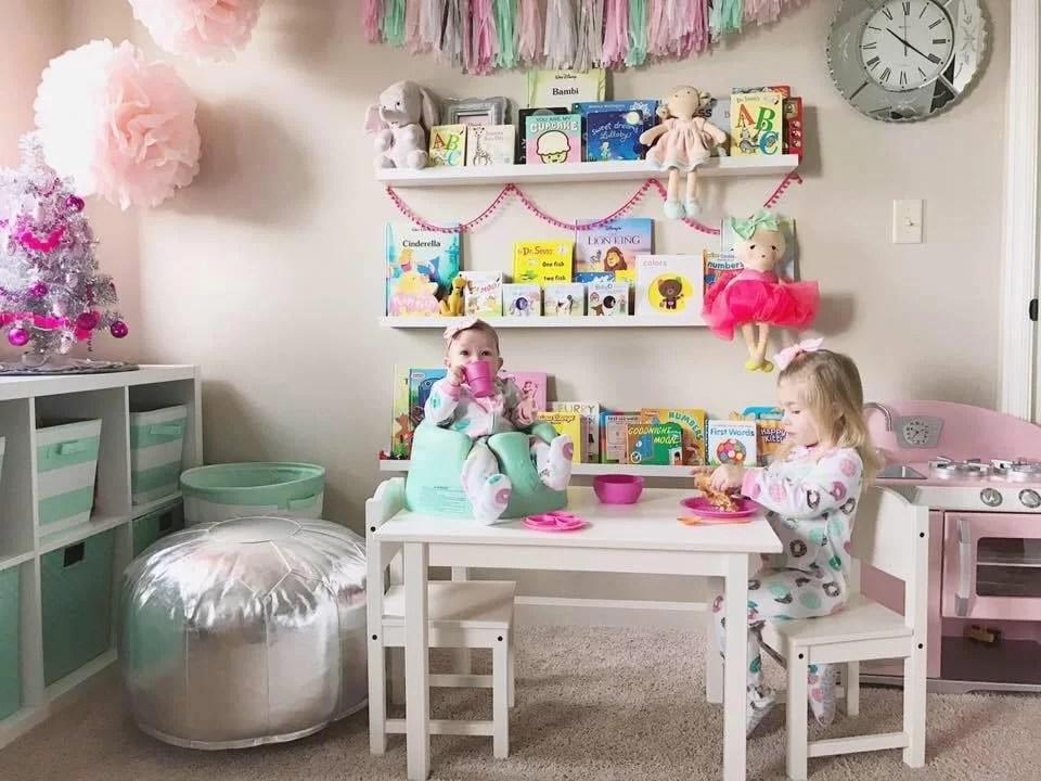 sisters-playroom-bumbo-bookshelves-girly playroom-donut tea party-tassels-playroom insp-mommy blogger-mom blog