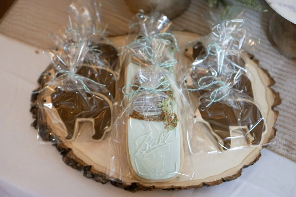 pregnant, maternity photos, baby boy, baby shower, boy shower, baby bear shower theme, woodland shower theme, naked cake, pinecone decor, winter baby shower, mason jar cookies, bear cookies, round wooden slab