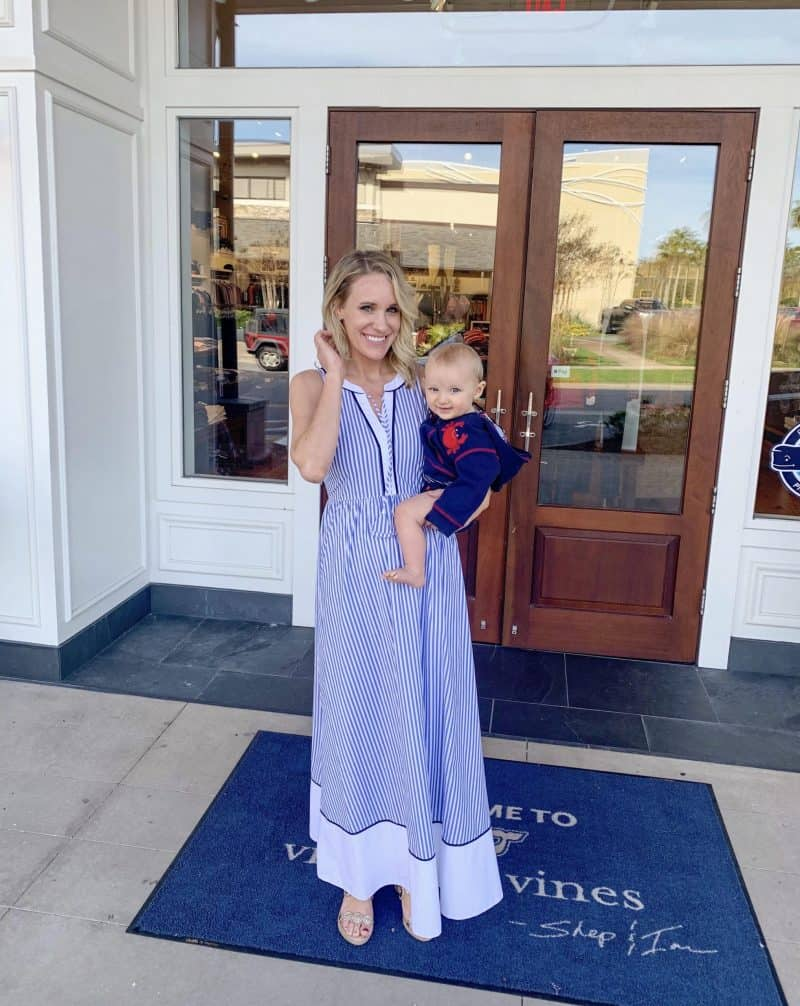 fashion blogger posing in preppy dress with son