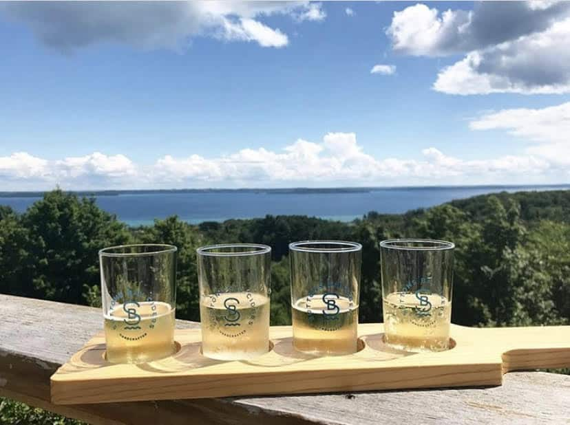 cider tasting | Living in Michigan by popular Michigan lifestyle blog, The House of Navy: image of cider glasses at Suttons Bay, MI.
