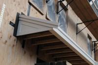 Roof Overhang at Front Door | Quivet Neck House
