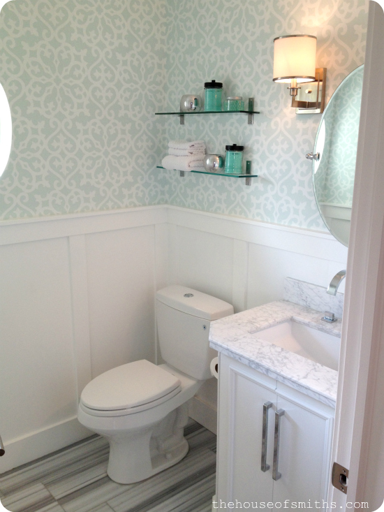 Powder room with wallpaper and marble floors - house of smiths