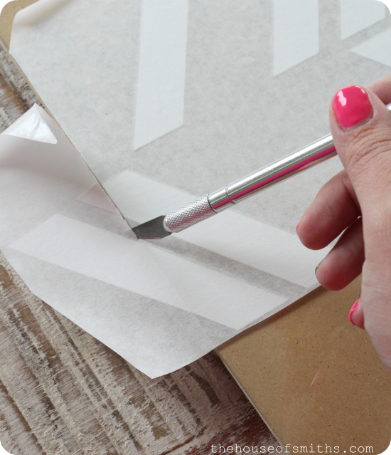 trimming vinyl with xacto knife - thehouseofsmiths.com