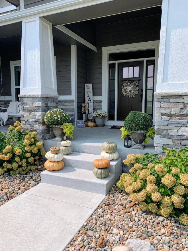 Cozy Fall Front Porch with lanterns and a DIY wreath on the door.