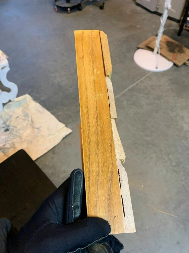 The frame attached to the side pieces for the Christmas tree box.