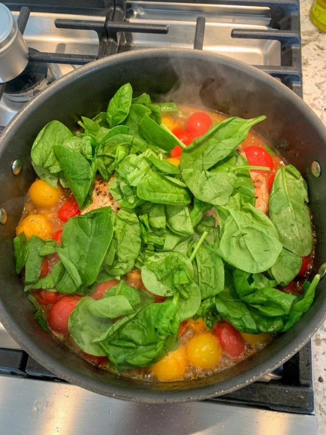 Creamy Tuscan Chicken with Cherry Tomatoes cooking.