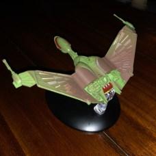Wings upswept for landing.