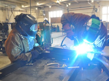 Neeginan College students learning welding.