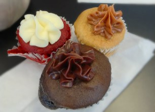 Red velvet, caramel and chocolate cupcakes topped with buttercream frosting. Image Credit: Tania Hussain