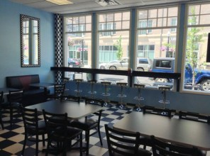 The interior of Auntie Em's Frozen Custard and Cupcakes, looking out onto Main Street in Carmel, Indiana. Image Credit: Tania Hussain