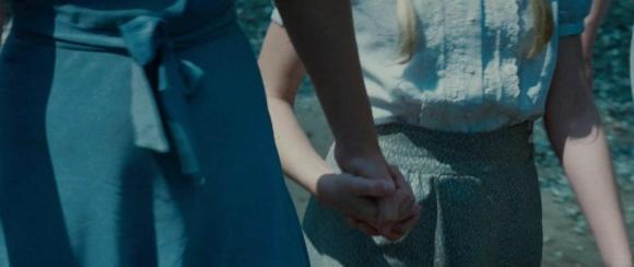 Movie Still: Katniss Holds Prim