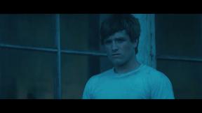 Movie Still: Peeta at The Bakery Looking at Katniss