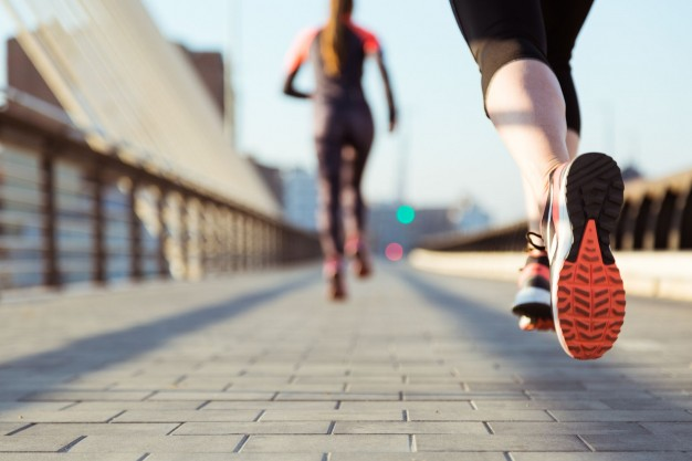 close-up-of-woman-running-with-unfocused-background.jpg