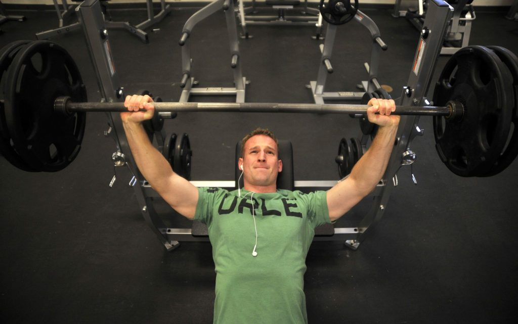 man doing barbell incline press
