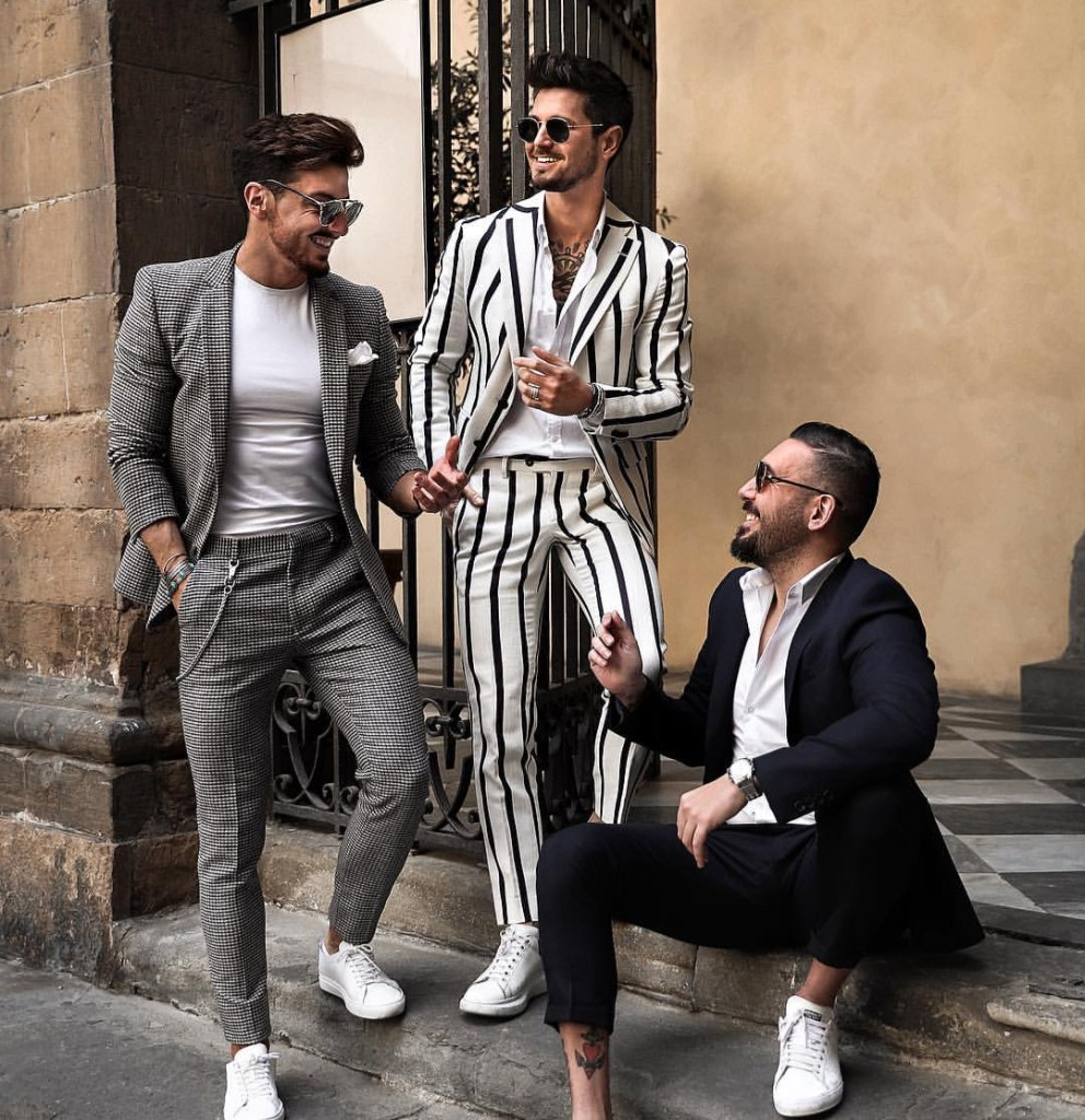 male models chatting with summer coats on