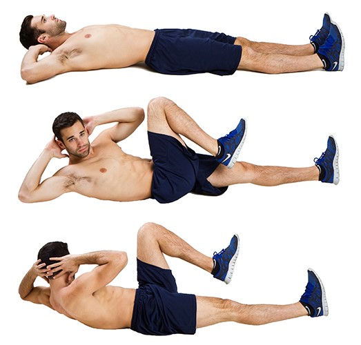 fitness trainer doing bicycle crunches