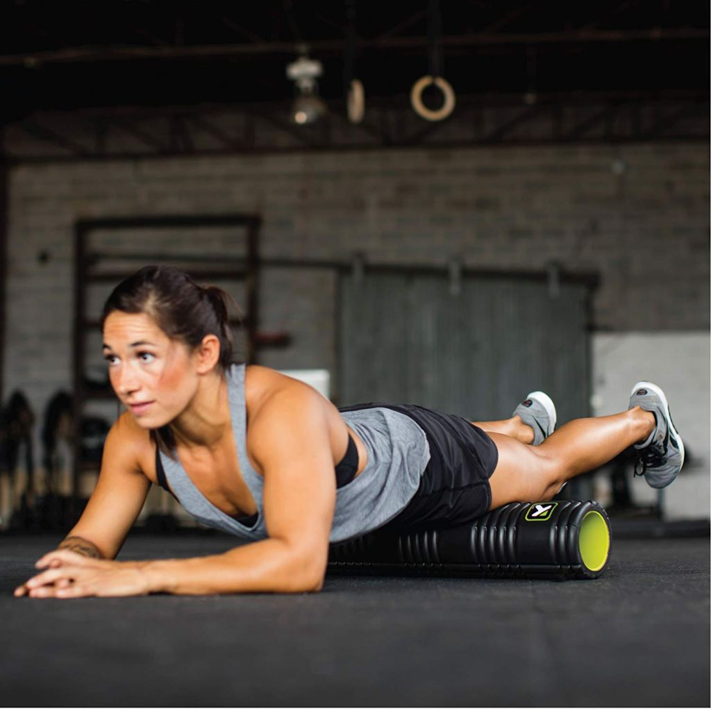 fit woman using TriggerPoint GRID Foam Roller