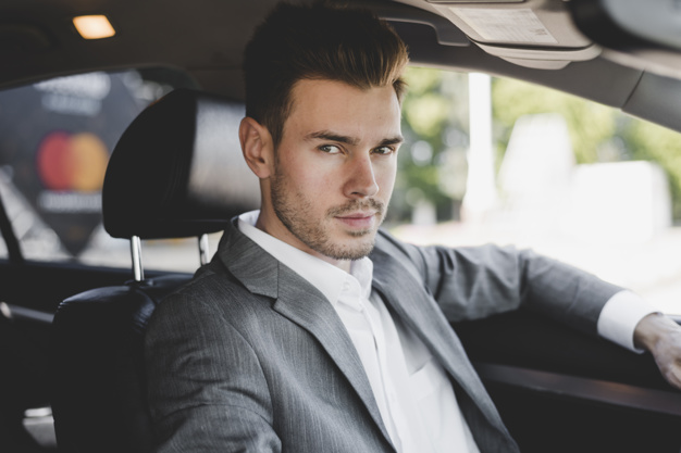handsome-well-dressed-young-businessman-in-car