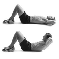 man lying on the floor doing crunches