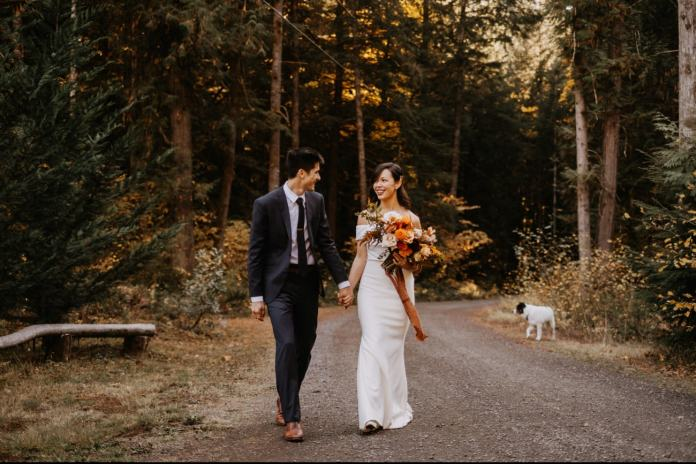 fall wedding couple walking