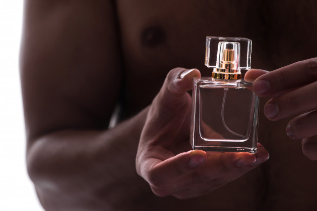 sexy-man-with-bottle-perfume