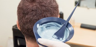 man at barber shop paint to dye his hair