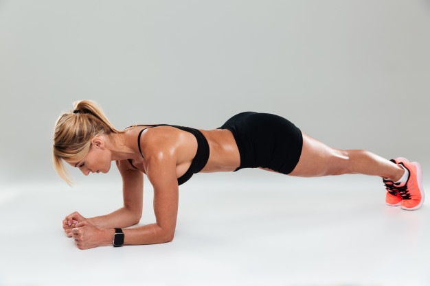 full-length-concentrated-fit-sportswoman-doing-plank-exercises