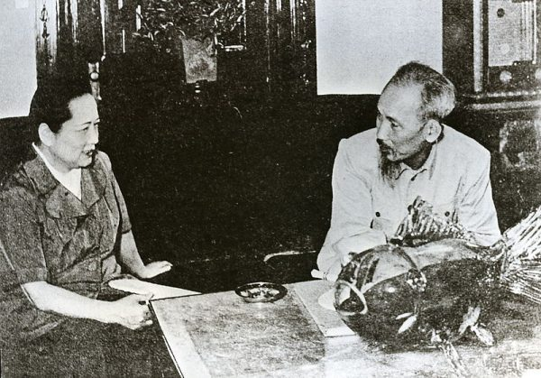 Soong Ching-ling, widow of Sun Yat-sen, meets with Vietnamese leader Ho Chi Minh.