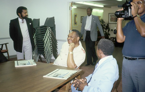 Don Griggs as president of WAG, Art Townsend, Ernie Wilson, Harry Carson with camera, Albert Casey.