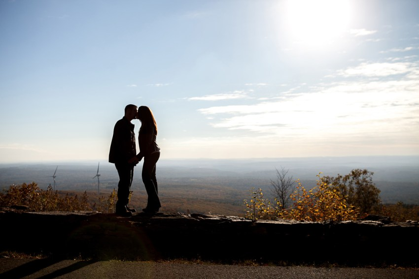 Engagement session photo taken at Wachuset Mountain during a fall engagement session. Feature amazing views, a silhouette of a couple coached by New England Wedding and Engagement Photographer, Alice Pepplow.