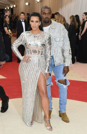 Kim Kardashian in Balmain and Kanye West