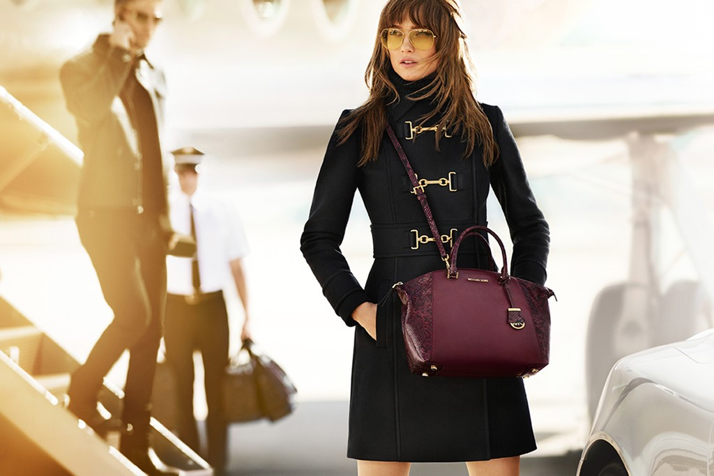 An ad visual from the MICHAEL Michael Kors fall 2015 campaign featuring Karmen Pedaru and Benjamin Eidem.