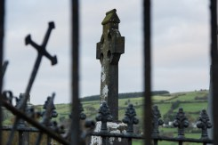 Celtic High Cross Behind Gate, Doon