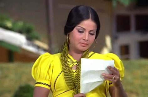 a still from the song, the actress is reading the letter